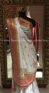 An elegant saree in white with peppy pink