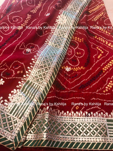 Beautiful green border red bandhej saree