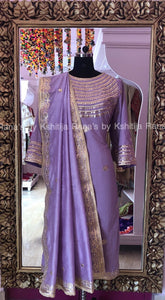 Beautiful pale purple salwar suit with rich neckline work