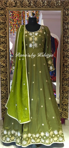An exquisite lotus green designer floor length dress