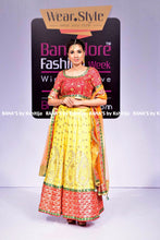 ranas-by-kshitija-yellow-lehenga-with-contrast-red-and-pale-orange-dupatta
