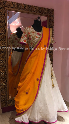 Witty white lehengas with orange and pink