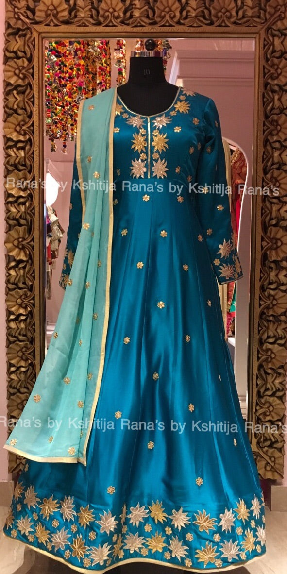 An exquisite lotus blue designer floor length dress