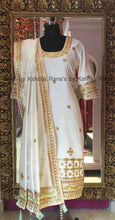 Elegant rich white salwar suit