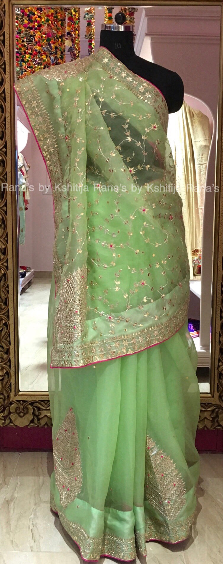 Pure Organza saree in gracious green color.