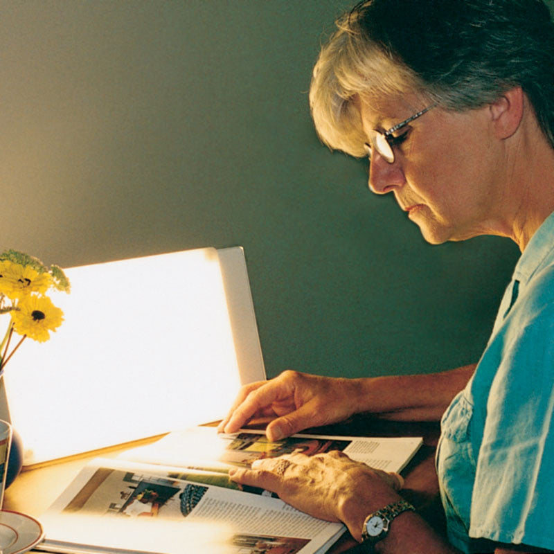 Reading with TRAVelite Therapy Desk Lamp