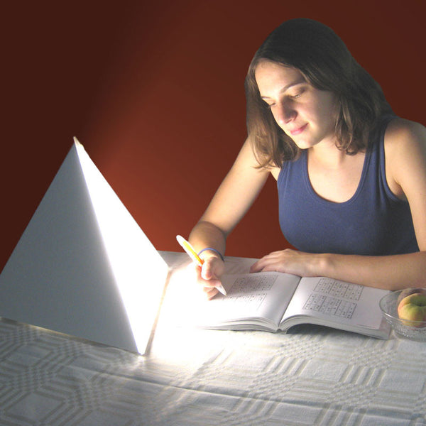 Reading With LUXOR Light Therapy Lamp