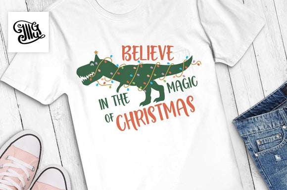 Believe in the magic of Christmas SVG, Christmas dinosaur svg, christmas lights svg, trex svg, christmas svg, christmas boy svg, boy clipart-by Illustrator Guru