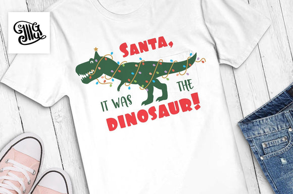 Santa, it was the dinosaur! svg, Christmas dinosaur svg, Christmas svg, christmas lights dinosaur, christmas trex svg, christmas kids-by Illustrator Guru
