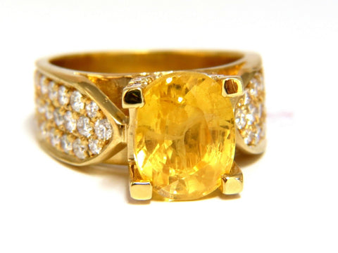 7.06ct Natural yellow sapphire ring 18kt. Raised Bead Set
