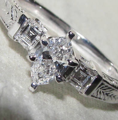 NATURAL .56CT MARQUISE & ASCHER CUT DIAMOND RING