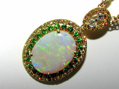 19.23CT NATURAL BLACK FIRE OPAL & TSAVORITE PENDANT 14KT & CHAIN