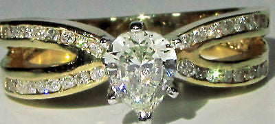 1.02CT PEAR SHAPE DIAMOND RING 14KT MODERN CLASS