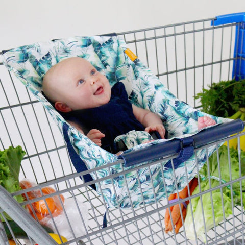 Baby in tropical leaf print shopping cart hammock