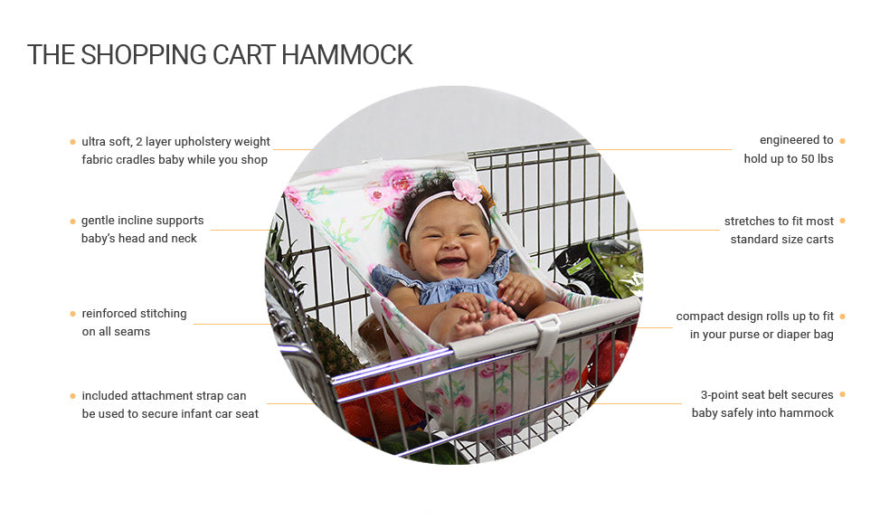 smiling baby in floral shopping cart hammock