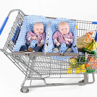 Two babies in shopping cart slings