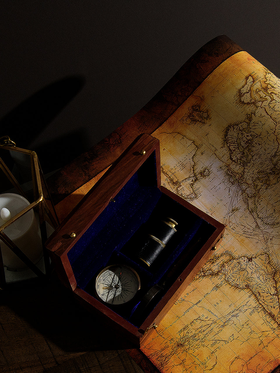 Wooden Box with Antique Telescope, Compass, and Magnifying Glass
