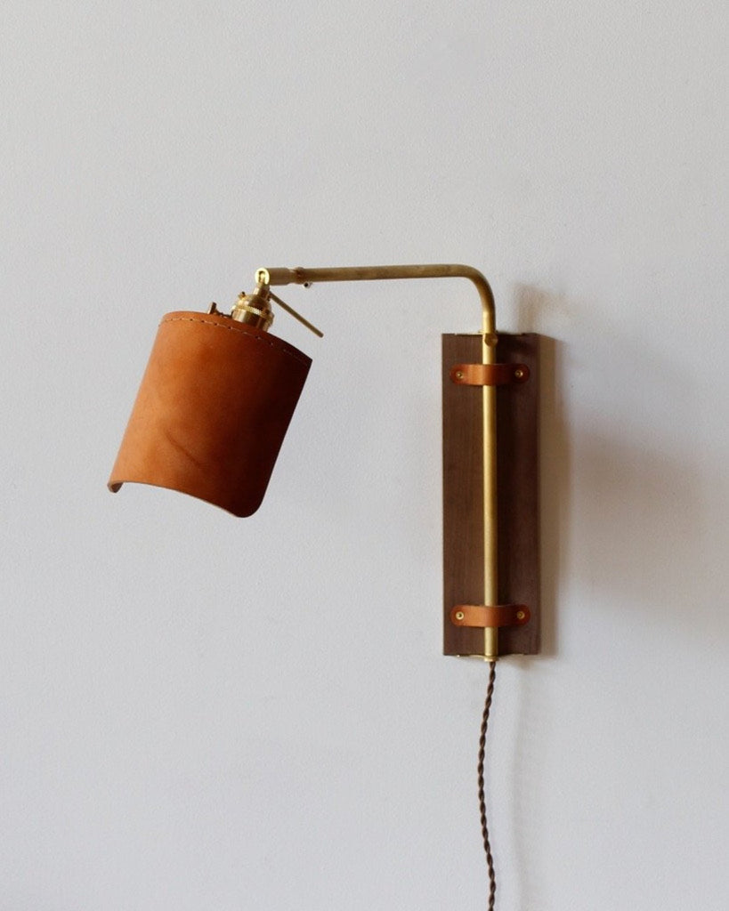 Robert Ogden Ava leather wood  brass wall sconce