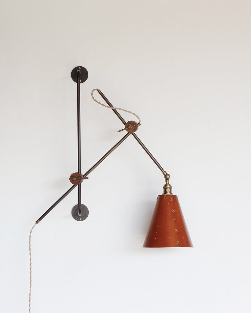 Lostine Grace articulating leather and iron wall light