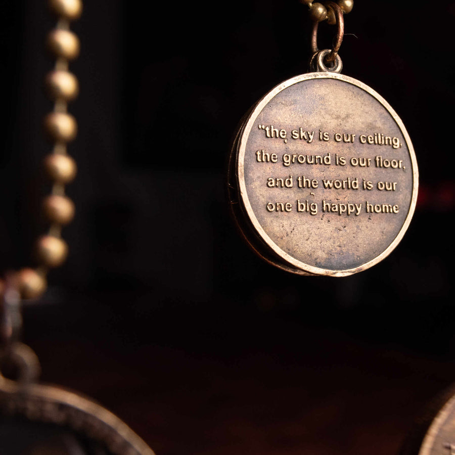 Closeup of medallion inscribed with inspirational phrase, side A