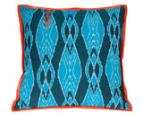 modern floor pillow with graphic pattern and orange leather trim