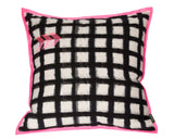 modern floor pillow with black and white pattern and pink embroidery