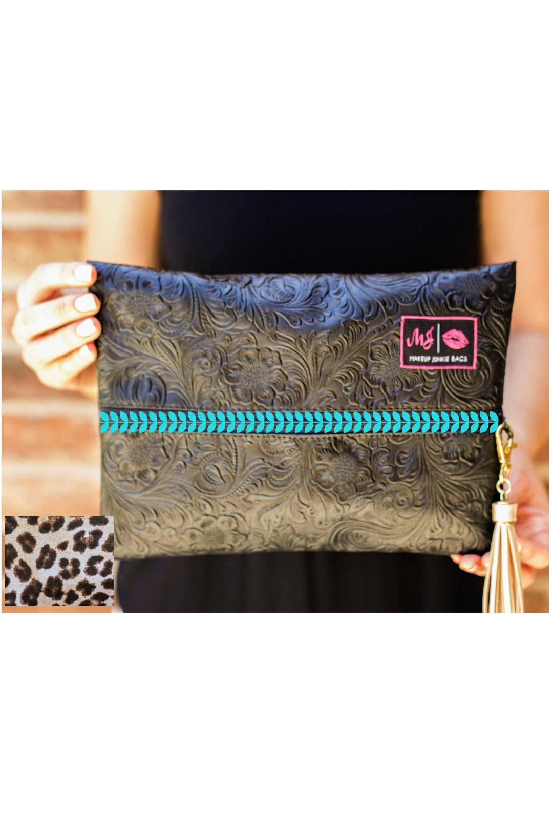 Exclusive Coal miner's Fancy Makeup Junkie bag with teal zipper and leopard lining.
