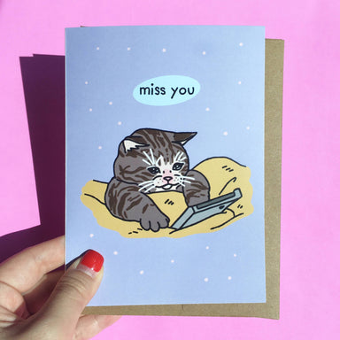 Miss you Sad Cat Cellphone Meme - Cat Greeting Card - Miss You Cards - Ping Hatta. Studio - Naiise