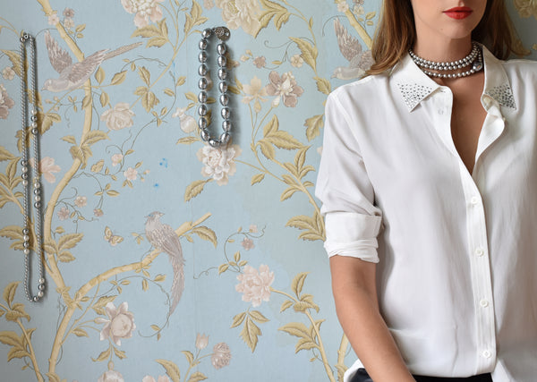 white silk shirt with pearl necklaces