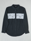 black silk shirt with white lace detailing flat lay