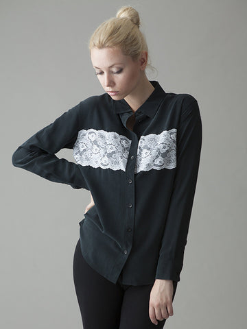 black silk blouse with white lace detail