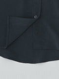 black silk shirt hem detail with embroidery