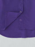 purple silk button up shirt hem detail