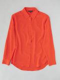 orange silk blouse flat lay