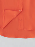 orange silk shirt hem detail