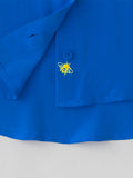 blue silk shirt with bee embroidery detail