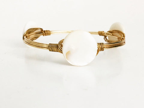 the BOBBY Bangle with White Shell Coin