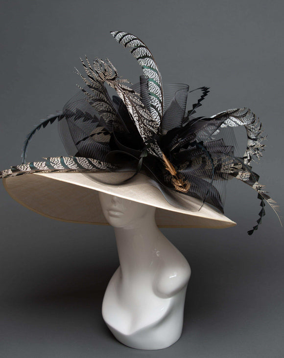 wide-brimmed ivory hat with zebra feathers