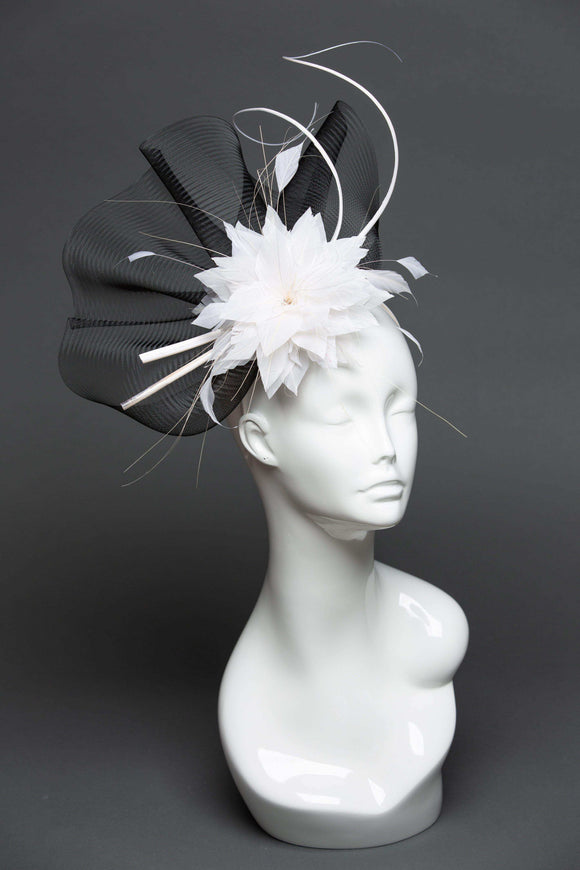 black fascinator with white feathers