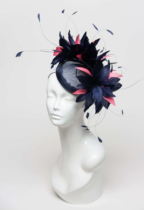 navy fascinator with navy and pink feathers