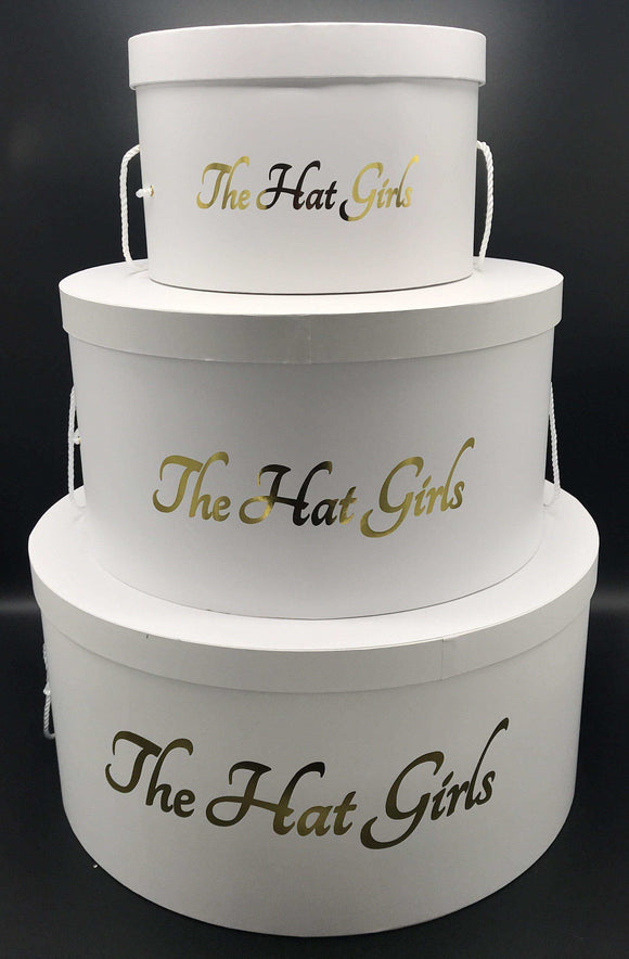 set of three stacked round hat boxes