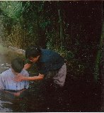 Our missionary, Joseph Nan, baptizing a new believer in Myanmar.