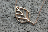 Sideways cut out branch Leaf pendant detailed with cubic zirconia necklace