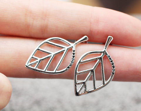 Sideways cut out branch Leaf detailed with cubic zirconia earrings
