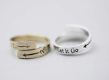 Let it go message and arrow signboard coiled wrap Ring, R1085G