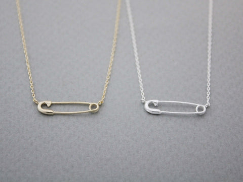 Safety Pin charm necklace in gold / silver (925 sterling silver / plated over Brass)