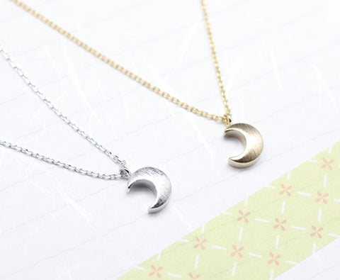 Crescent moon pendant Necklace in gold and silver