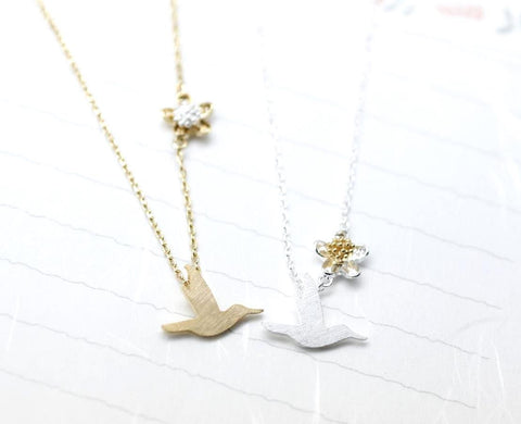 Hummingbird  and flower pendant necklace in silver/ gold