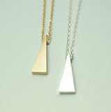 LONG textured triangle pendant necklace in gold / silver