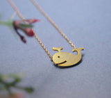 Whale charm Necklace in silver and gold